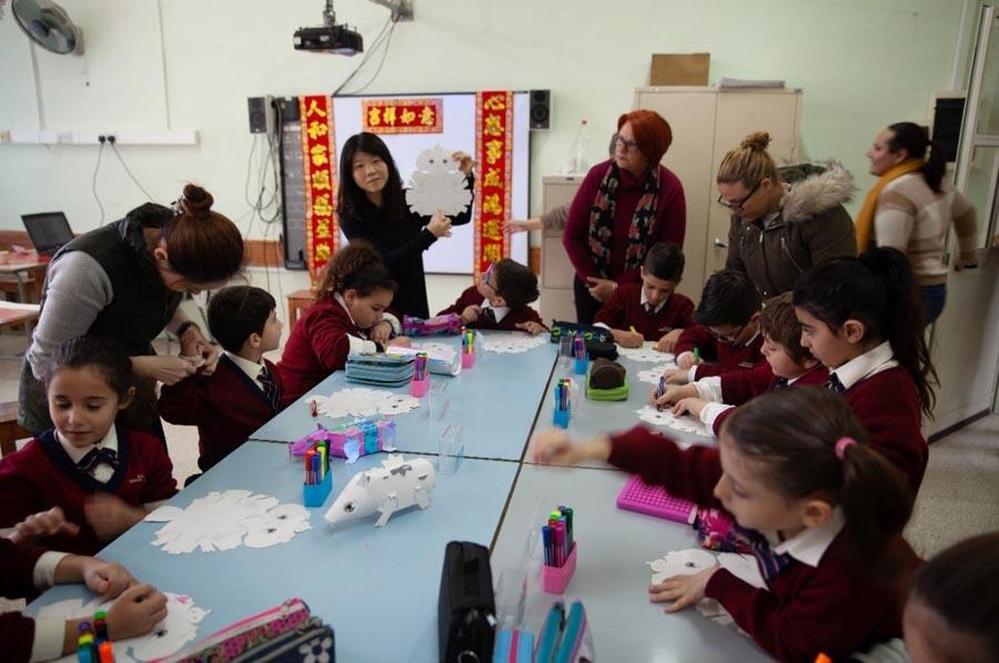 Artists from Taiwan introduce the Chinese zodiac to students at a primary school in Kalkara, Malta, Jan. 10, 2019. China assigns an animal and its reputed attributes to each year in a repeating 12-year cycle, with 2019 the Year of the Pig. A new zodiac animal exhibition is underway at the China Cultural Center in Malta through Jan. 25. (Photo/Chinaculture.org)