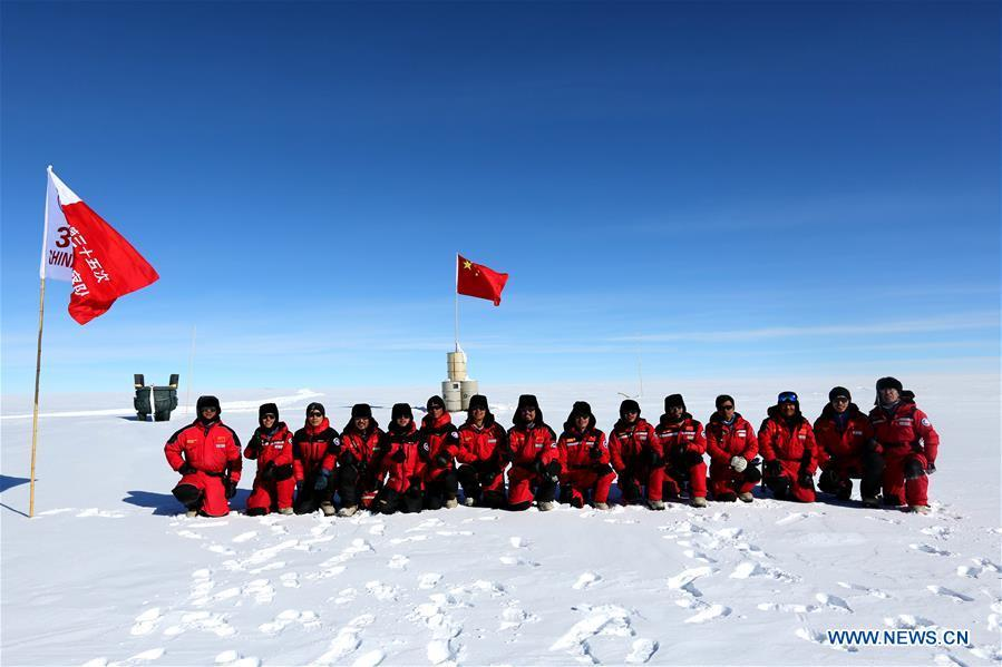 Members of China\'s 35th Antarctic expedition team pose for a group photo at the area of the Dome Argus (Dome A), the peak of Antarctica\'s inland icecap, in Antarctica, Jan. 16, 2019. (Xinhua/Liu Shiping)