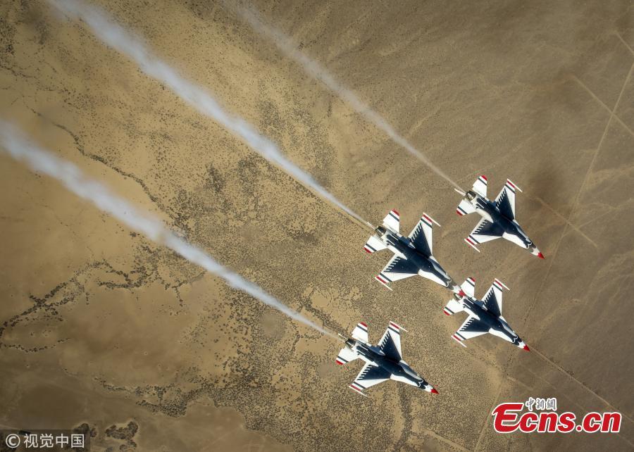 The Thunderbirds Diamond formation pilots perform the Diamond Roll maneuver over the Nevada Test and Training Range during a training flight, Feb. 28, 2018. (Photo/VCG)