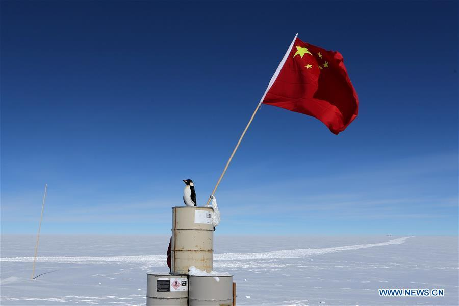 The Chinese national flag is seen at the area of the Dome Argus (Dome A), the peak of Antarctica\'s inland icecap, in Antarctica, Jan. 16, 2019. (Xinhua/Liu Shiping)