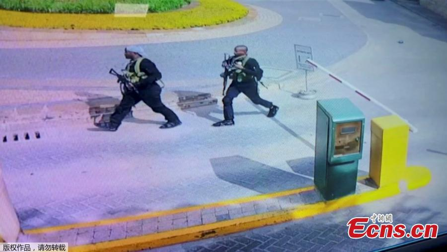 Heavily armed attackers walk through the Nairobi hotel compound in this grab taken from security camera footage released to the local media. Kenyan security forces have killed all the Somali militants who stormed an upscale Nairobi hotel compound, taking at least 21 lives and forcing hundreds of people into terrifying escapes, the government said on Wednesday. (Photo/Agencies)