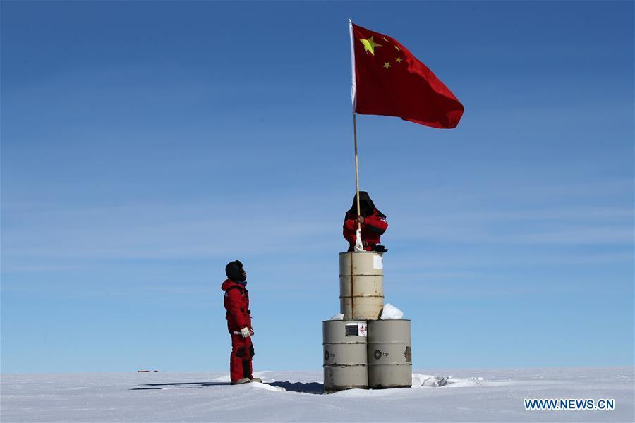 A member of China\'s 35th Antarctic expedition team erects the Chinese national flag at the area of the Dome Argus (Dome A), the peak of Antarctica\'s inland icecap, in Antarctica, Jan. 16, 2019. (Xinhua/Liu Shiping)