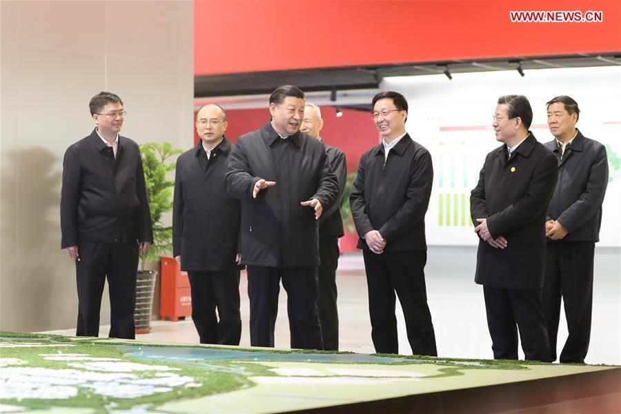 Chinese President Xi Jinping listens to the introduction of the general plan, policy system and construction of the Xiongan New Area at the Xiongan citizen service center during his inspection in the Xiongan New Area, north China\'s Hebei Province, Jan. 16, 2019. (Xinhua/Ju Peng)