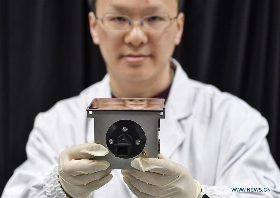 A staff member of Institute of Optics and Electronics of the Chinese Academy of Sciences shows a sample of the topographical camera installed on the lander of the Chang\'e-4 probe in Chengdu, southwest China\'s Sichuan Province, Jan. 17, 2019. The topographical camera installed on the lander of the Chang\'e-4 probe is responsible for both taking colorful high-resolution images on the lunar surface and monitoring the lunar rover Yutu-2. China\'s Chang\'e-4 lunar probe, comprising a lander and a rover, landed on the far side of the moon on Jan. 3, 2019. (Xinhua/Liu Kun)