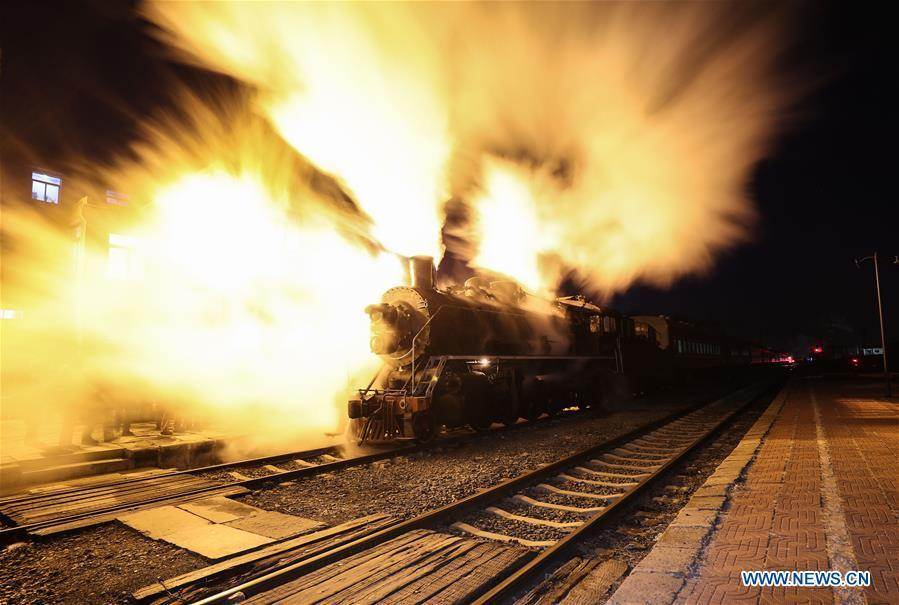 Photo taken on Jan. 17, 2019 shows a steam locomotive at the Diaobingshan Station, northeast China\'s Liaoning Province. A 5-day steam locomotive tourism event kicked off in Diaobingshan on Thursday. Tourists can visit the steam locomotive museum, take pictures of steam locomotives and watch exhibitions during the event. (Xinhua/Pan Yulong)