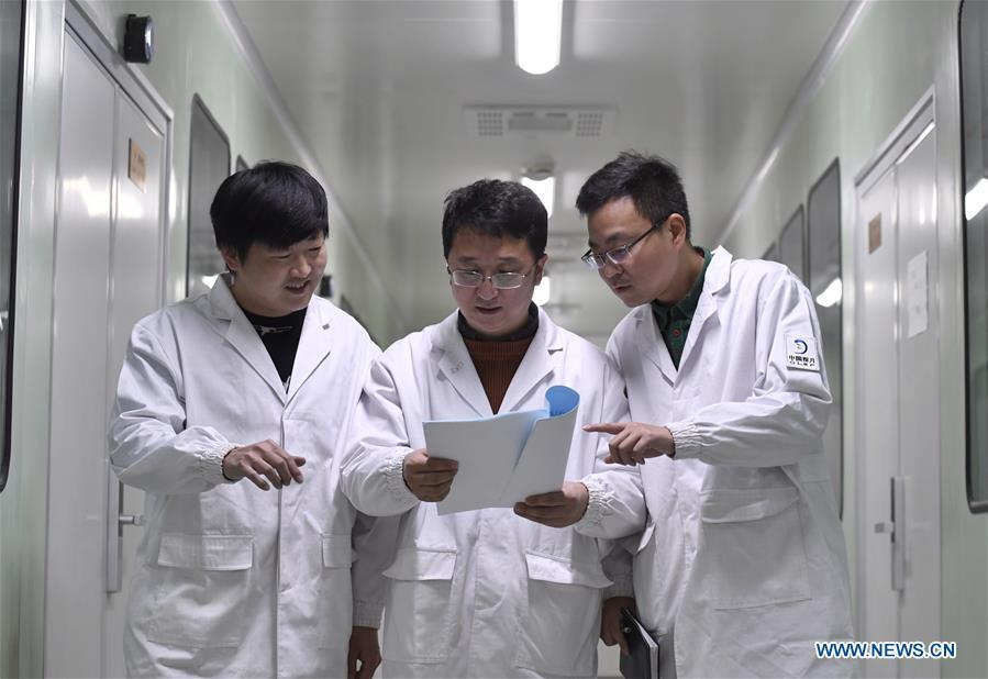 Staff members of Institute of Optics and Electronics of the Chinese Academy of Sciences discuss the plan of testing the topographical camera installed on the lander of the Chang\'e-4 probe in Chengdu, southwest China\'s Sichuan Province, Jan. 17, 2019. The topographical camera installed on the lander of the Chang\'e-4 probe is responsible for both taking colorful high-resolution images on the lunar surface and monitoring the lunar rover Yutu-2. China\'s Chang\'e-4 lunar probe, comprising a lander and a rover, landed on the far side of the moon on Jan. 3, 2019. (Xinhua/Liu Kun)