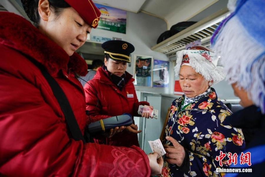 Passengers are seen on a train to Guiyang City, Guizhou Province, Jan. 17, 2019. The railway line linking Guiyang City and Yuping County in Tongren County has been running for 44 years - opening in 1975 - connecting the villages of the many ethnic groups residing deep in the mountains with the outside world. The 342-km journey takes about seven hours - incredibly slow when compared with the speeds of China's increasingly ubiquitous bullet trains. (Photo: China News Service/He Junyi)