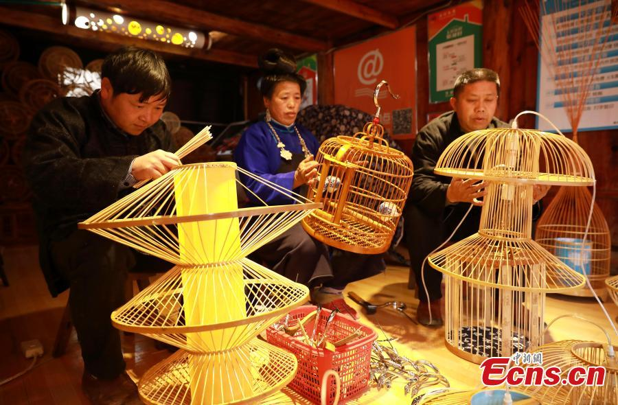 Villagers make bird cage-shaped lanterns, to be used in Chinese New Year celebrations, in Kala Village, Danzhai County, Southwest China\'s Guizhou Province, Jan. 17, 2019. Wang Yuhe is a master of the craft, recognized as an intangible cultural heritage by the province in 2008. The village is famous for producing bird cage-shaped lanterns. (Photo: China News Service/Huang Xiaohai)