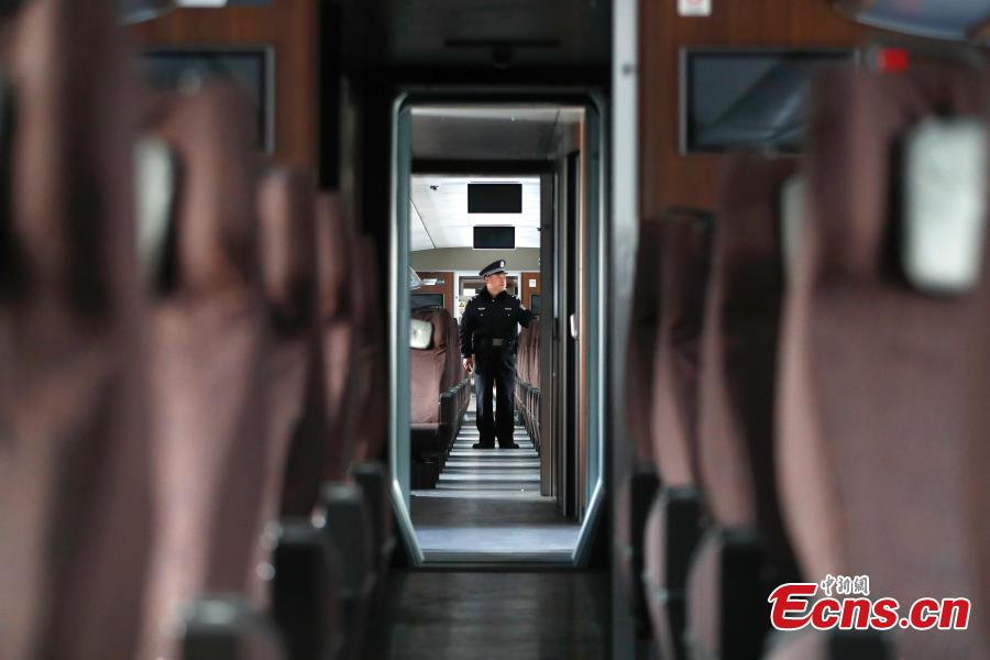A police dog is seen completing a safety patrol at a bullet train service station in Beijing, Jan. 17, 2019. Beijing police have increased security checks on trains at the service station for routine inspections and maintenance as the Spring Festival travel rush approaches. (Photo: China News Service/Fu Tian)