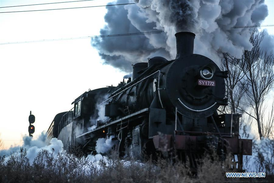 Photo taken on Jan. 17, 2019 shows a steam locomotive heading to the steam locomotive museum of Tiefa Energy Co., Ltd from Diaobingshan Station, northeast China\'s Liaoning Province. A 5-day steam locomotive tourism event kicked off in Diaobingshan on Thursday. Tourists can visit the steam locomotive museum, take pictures of steam locomotives and watch exhibitions during the event. (Xinhua/Pan Yulong)