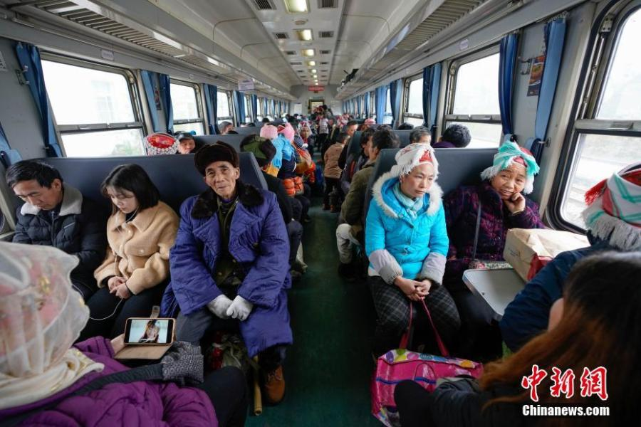 Passengers are seen on a train to Guiyang City, Guizhou Province, Jan. 17, 2019. The railway line linking Guiyang City and Yuping County in Tongren County has been running for 44 years - opening in 1975 - connecting the villages of the many ethnic groups residing deep in the mountains with the outside world. The 342-km journey takes about seven hours - incredibly slow when compared with the speeds of China\'s increasingly ubiquitous bullet trains. (Photo: China News Service/He Junyi)