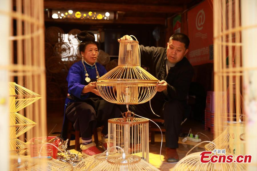 Craftsman Wang Yuhe makes a bird cage-shaped lantern, to be used in Chinese New Year celebrations, in Kala Village, Danzhai County, Southwest China\'s Guizhou Province, Jan. 17, 2019. Wang is a master of the craft, recognized as an intangible cultural heritage by the province in 2008. The village is famous for producing bird cage-shaped lanterns. (Photo: China News Service/Huang Xiaohai)