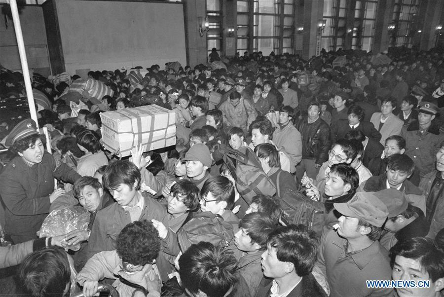 Passengers queue to enter the Beijing Railway Station during the Spring Festival travel rush in Beijing, capital of China, Jan. 12, 1993. Returning to hometowns remains the most important part of the Chinese Spring Festival. Whether self-driving, or taking the trains or flights, homecomings and family gatherings are a priority for many Chinese. The annual travel rush around the festival, known as \