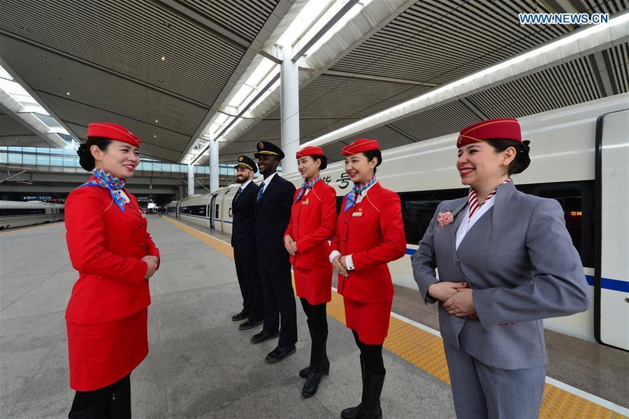 Foreign volunteers receive professional training at Xi\'an North Railway Station in Xi\'an, capital of northwest China\'s Shaanxi Province, Jan. 20, 2019. Three foreign student volunteers from Xi\'an Jiaotong University came to Xi\'an North Railway Station on Sunday to familiarize themselves with the train staff members\' work. They would serve passengers during the Spring Festival travel rush. The Spring Festival, or the Year of the Pig in the Chinese lunar calendar, will begin on Feb. 5 this year. The 40-day 2019 Spring Festival travel rush started on Jan. 21, with 3 billion trips expected to be made. (Xinhua/Tang Zhenjiang)