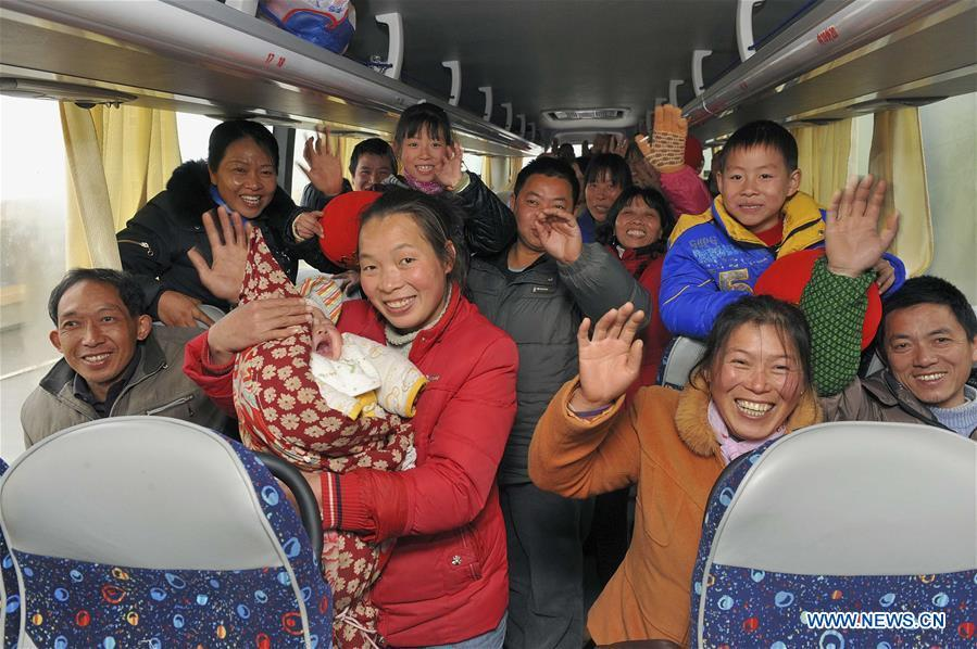Migrant workers of a private enterprise get on a bus heading for their hometowns in Shaoxing, east China\'s Zhejiang Province, Jan. 28, 2011. Returning to hometowns remains the most important part of the Chinese Spring Festival. Whether self-driving, or taking the trains or flights, homecomings and family gatherings are a priority for many Chinese. The annual travel rush around the festival, known as \