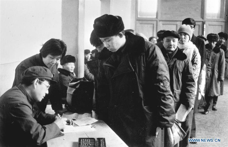 File Photo taken on Jan. 6, 1984 shows the newly-set group ticket desk at the Beijing Railway Station in Beijing, capital of China. Returning to hometowns remains the most important part of the Chinese Spring Festival. Whether self-driving, or taking the trains or flights, homecomings and family gatherings are a priority for many Chinese. The annual travel rush around the festival, known as \