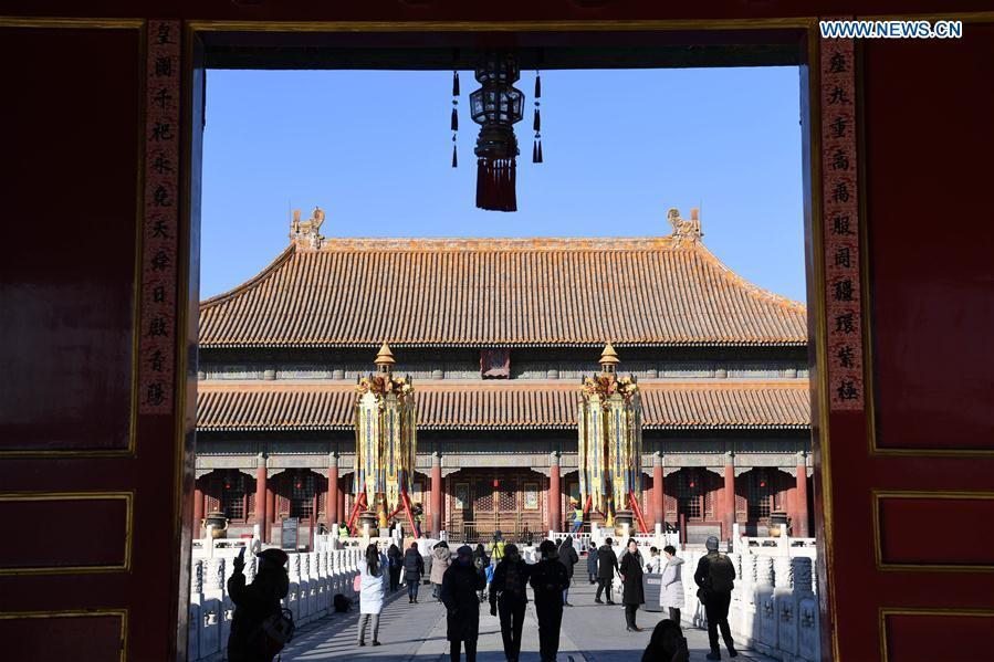 Longevity lanterns are installed before the Qianqing Gong, or the Palace of Heavenly Purity, at the Palace Museum, also known as the Forbidden City, in Beijing, capital of China, Jan. 21, 2019. The traditional lanterns recovered by the Palace Museum in accordance with historical archives from the Qing Dynasty (1644-1911) are opened to the public Monday, as a part of the exhibition of \