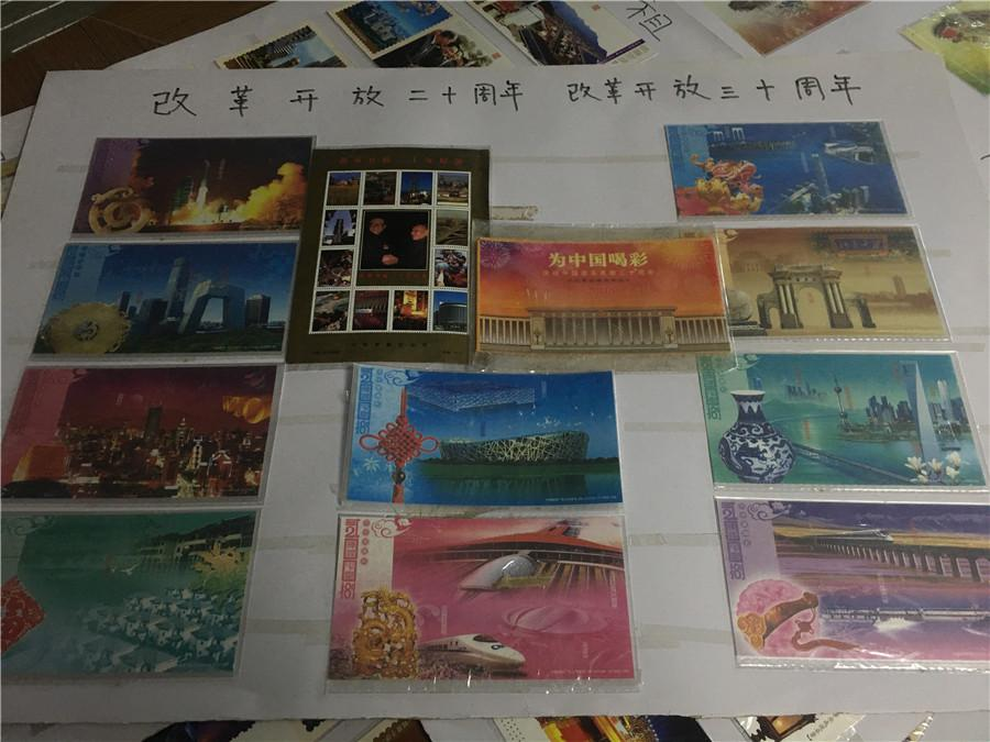 Part of Kong Xiangming\'s postcard collection, featuring the 60th anniversary of the founding of the People\'s Republic of China.  (Photo/chinadaily.com.cn)