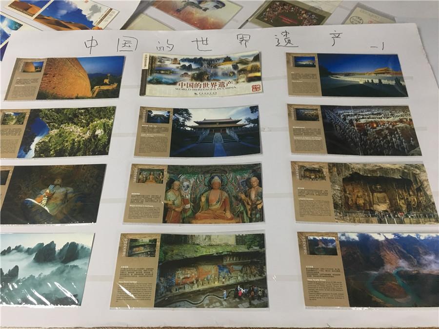 Part of Kong Xiangming\'s postcard collection, featuring world heritage sites in China. (Photo/chinadaily.com.cn)