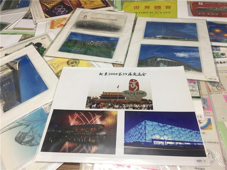 Part of Kong Xiangming\'s postcard collection, featuring the Beijing 2008 Olympic Games. (Photo/chinadaily.com.cn)