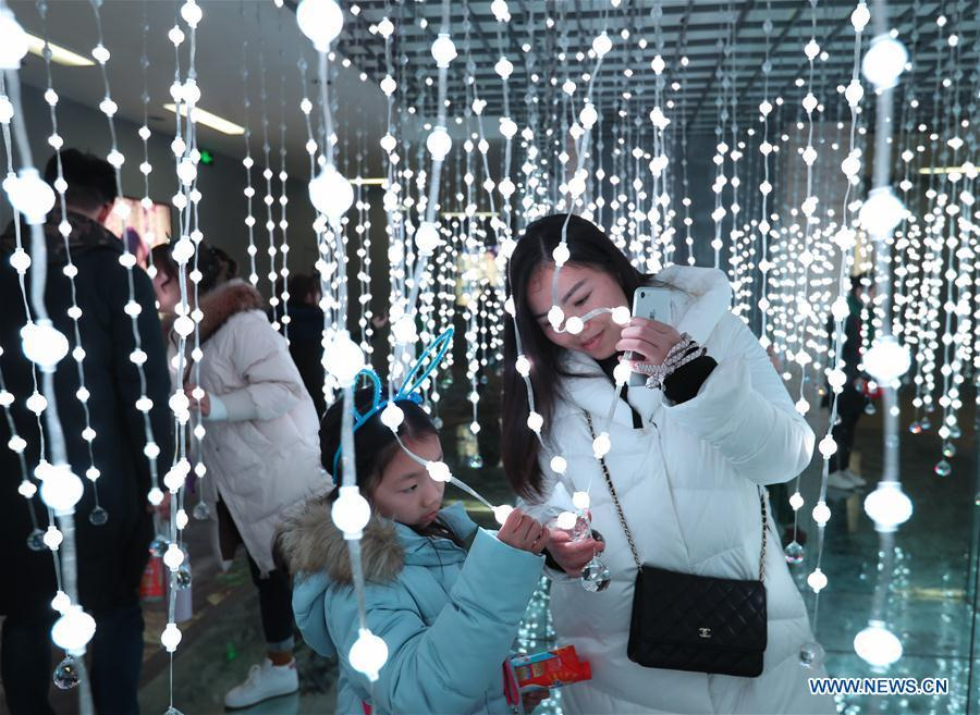 People view lighting beads during a lantern festival in Zigong, southwest China\'s Sichuan Province, Jan. 21, 2019. (Xinhua/Jiang Hongjing)