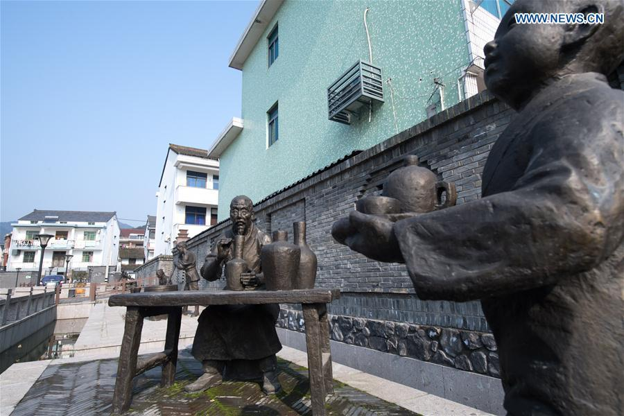 Statues depicting celadon craftsmen are seen at Dashan Xiaowu Village in Shangyu District of Shaoxing, east China\'s Zhejiang Province, Jan. 22, 2019. As the birthplace of celadon, Shangyu District is giving full support to revive the local celadon culture, protecting ancient relics, promoting celadon artists and boosting tourism. (Xinhua/Weng Xinyang)