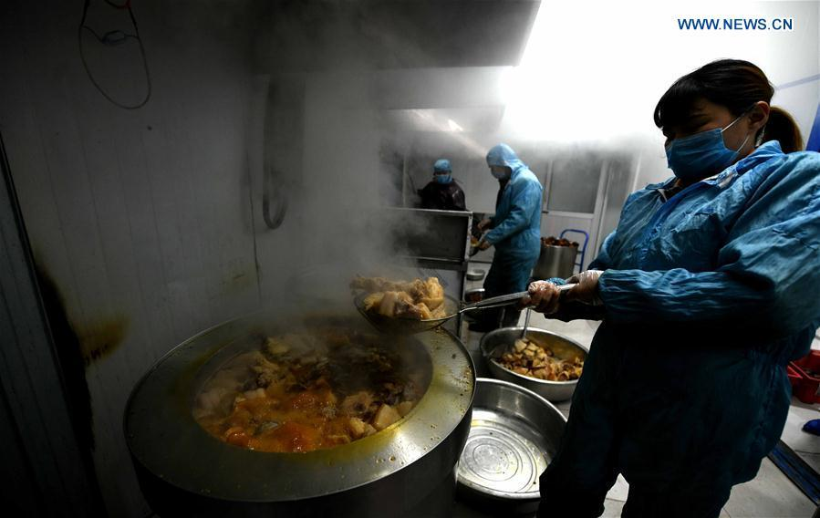 Workers make Shuizhagou preserved meat at a factory in Pingshan County, north China\'s Hebei Province, Jan. 22, 2019. Shuizhagou preserved meat, a local speciality famous for its delicate taste and fine making method, is a treat for families and friends on important occasions. (Xinhua/Chen Qibao)
