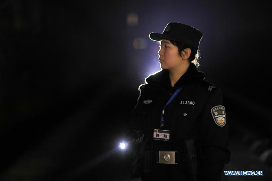 A policewoman patrols the high-speed railway in Rongjiang County, southwest China\'s Guizhou Province, Jan. 22, 2019. Rongjiang Railway Police Station conducts two or three safety inspections at night every week during the Spring Festival travel rush. (Xinhua/Ou Dongqu)