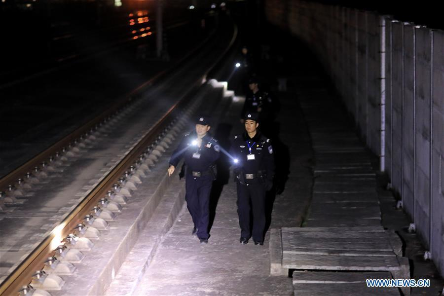Police officers patrol on Guiyang-Guangzhou High-speed Railway, Jan. 22, 2019. Rongjiang Railway Police Station conducts two or three safety inspections at night every week during the Spring Festival travel rush. (Xinhua/Ou Dongqu)