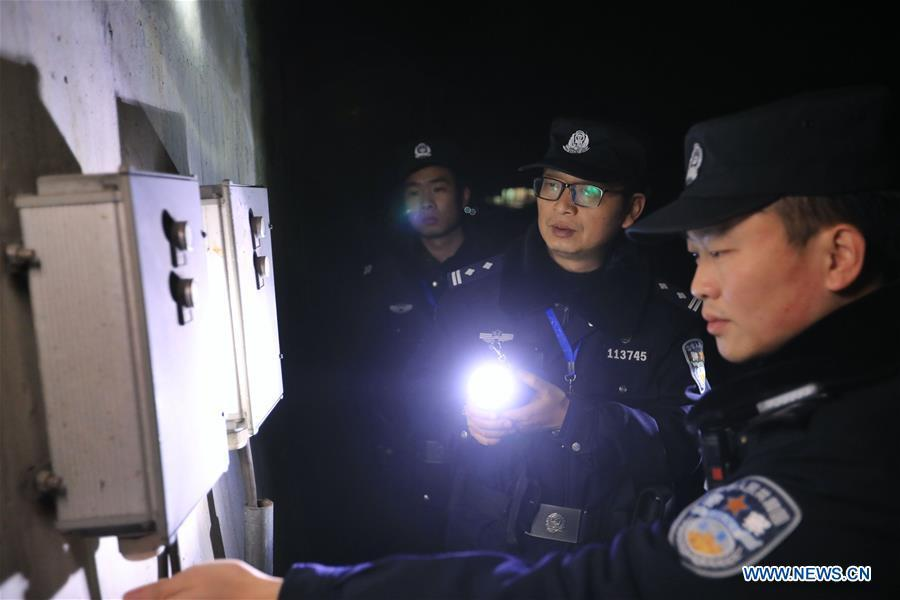 Policemen check the operation of the facilities along the high-speed railway in Rongjiang County, southwest China\'s Guizhou Province, Jan. 22, 2019. Rongjiang Railway Police Station conducts two or three safety inspections at night every week during the Spring Festival travel rush. (Xinhua/Ou Dongqu)