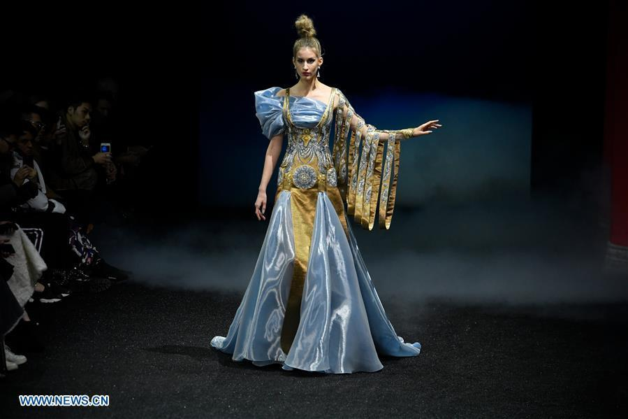 A model presents a creation of Guo Pei during the Haute Couture 2019 Spring/Summer collection shows in Paris, France, on Jan. 23, 2019. (Xinhua/Piero Biasion)