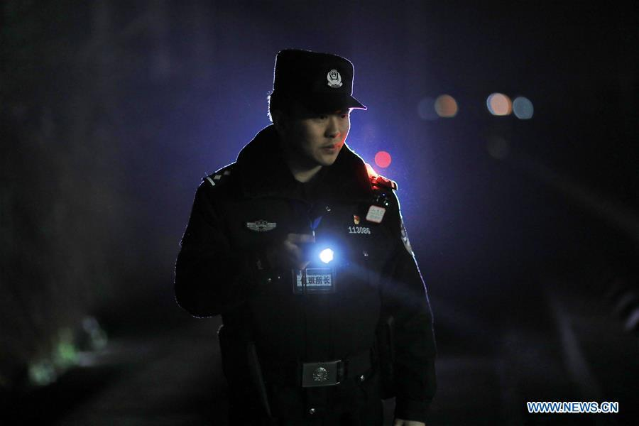 A policeman patrols the high-speed railway in Rongjiang County, southwest China\'s Guizhou Province, Jan. 22, 2019. Rongjiang Railway Police Station conducts two or three safety inspections at night every week during the Spring Festival travel rush. (Xinhua/Ou Dongqu)