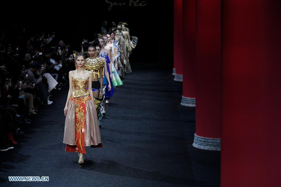 Models present creations of Guo Pei during the Haute Couture 2019 Spring/Summer collection shows in Paris, France, on Jan. 23, 2019. (Xinhua/Piero Biasion)