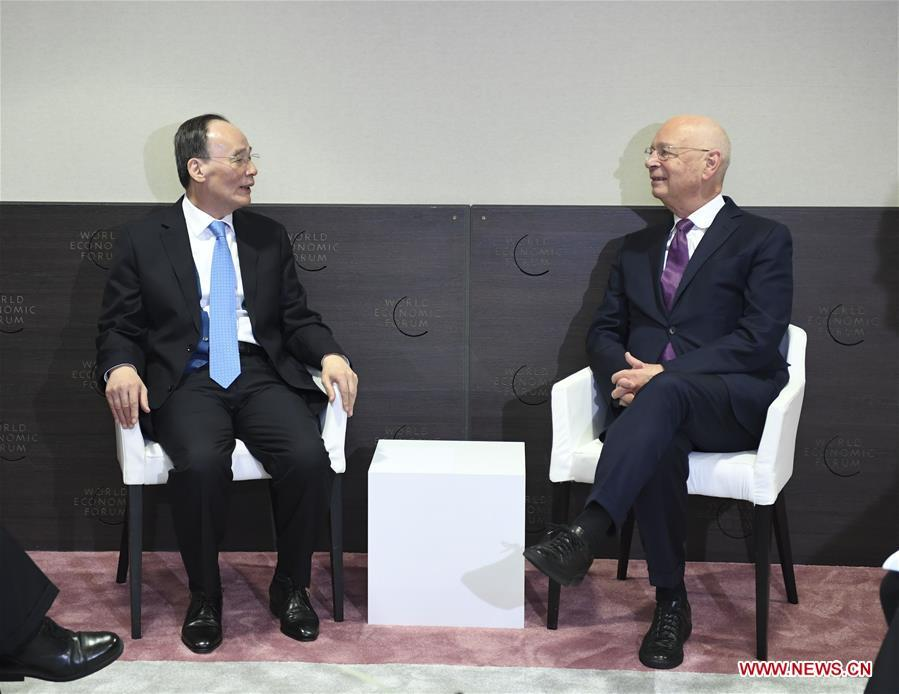 Chinese Vice President Wang Qishan (L) meets with World Economic Forum (WEF) Founder and Executive Chairman Klaus Schwab during the 2019 Annual Meeting of the World Economic Forum in Davos, Switzerland. Wang delivered a speech titled \