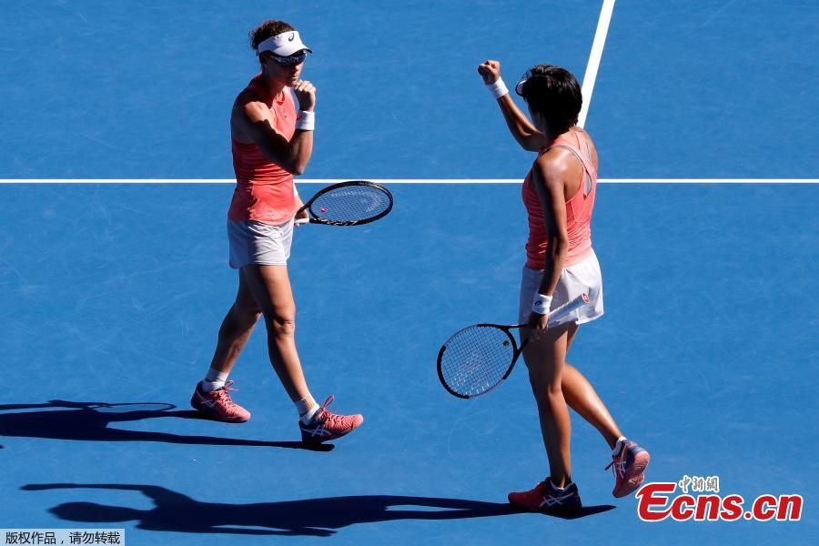 Zhang Shuai of China and Samantha Stosur of Australia celebrate after winning the women\'s doubles final match against Timea Babos of Hungary and Kristina Mladenovic of France at 2019 Australian Open in Melbourne, Australia, Jan. 25, 2019. (Photo/Agencies)
