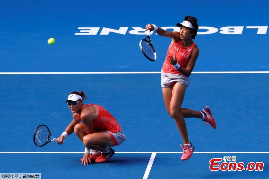 Zhang Shuai of China and Samantha Stosur of Australia compete during the women\'s doubles final match against Timea Babos of Hungary and Kristina Mladenovic of France at 2019 Australian Open in Melbourne, Australia, Jan. 25, 2019. (Photo/Agencies)