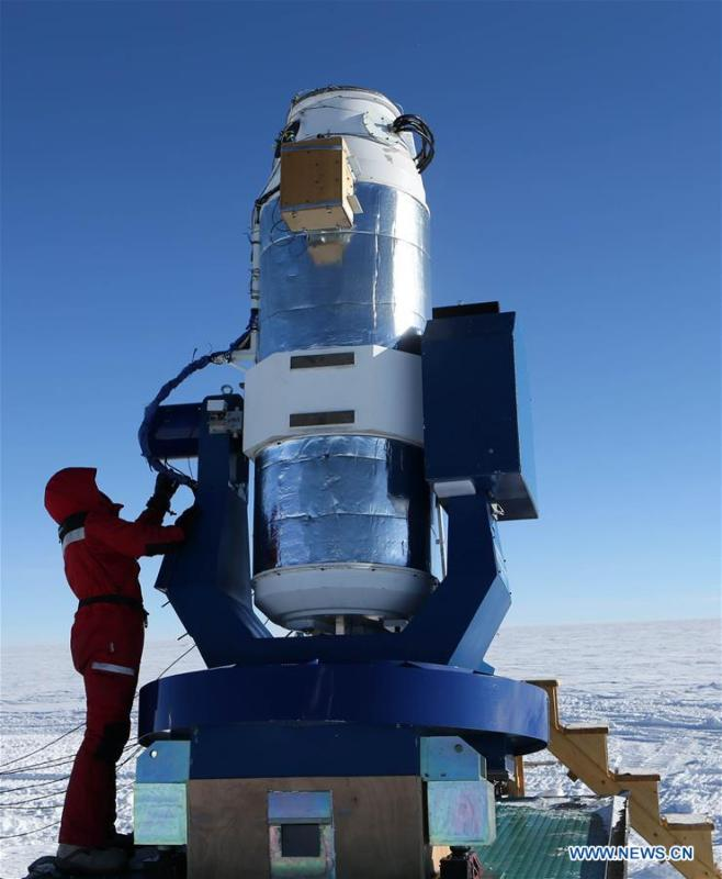 A member of China\'s 35th Antarctic expedition team checks the AST3-2 telescope at the Kunlun Station in Antarctica, Jan. 23, 2019. The Kunlun team of China\'s 35th Antarctic expedition withdrew from the Kunlun Station on Thursday after completing various scientific exploration projects at the peak of Antarctic\'s inland icecap. (Xinhua/Liu Shiping)