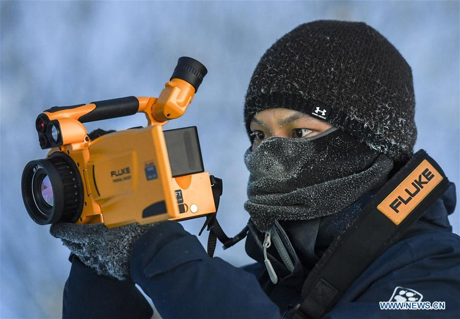 Researcher Yang Tao collects data of snow cover in Sa\'erwuzike Village in Kaxajar township of Zhaosu County, northwest China\'s Xinjiang Uygur Autonomous Region, Jan. 18, 2019. A nine-member research team with an average age under 30 from the Xinjiang Institute of Ecology and Geography under the Chinese Academy of Sciences started a research on snow cover on the Tianshan Mountains in Xinjiang. Snow cover on the Tianshan Mountains is an important source of water resources. Snowmelt provides an abundant water supply for river flow in this area and also affects the ecological system of agricultural and animal husbandry production in the downstream oasis. (Xinhua/Hu Huhu)