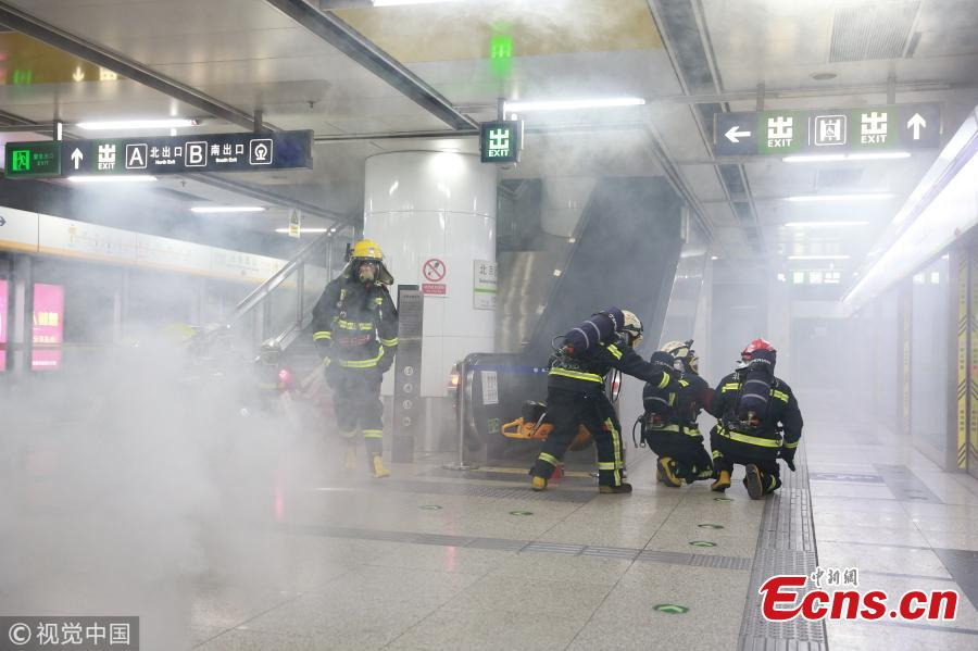 A firefighting drill is held at Beijing West Railway Station on Jan 24, 2019. The fire brigade held the emergency drill to beef up security for the Spring Festival travel rush. (Photo/VCG)