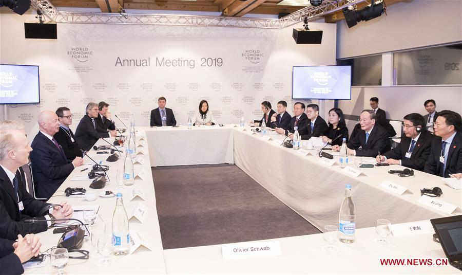 Chinese Vice President Wang Qishan attends a symposium with figures from international industrial and commercial circles during the 2019 Annual Meeting of the World Economic Forum in Davos, Switzerland. Wang delivered a speech titled \