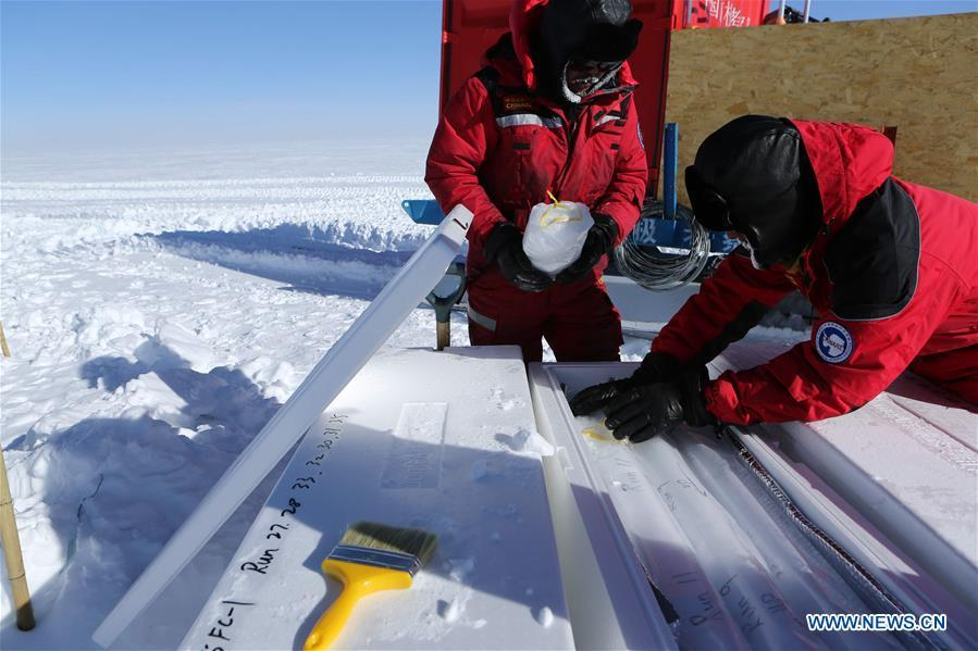 Members of China\'s 35th Antarctic expedition team package the samples of ice and snow at the Kunlun Station in Antarctica, Jan. 22, 2019. The Kunlun team of China\'s 35th Antarctic expedition withdrew from the Kunlun Station on Thursday after completing various scientific exploration projects at the peak of Antarctic\'s inland icecap. (Xinhua/Liu Shiping)