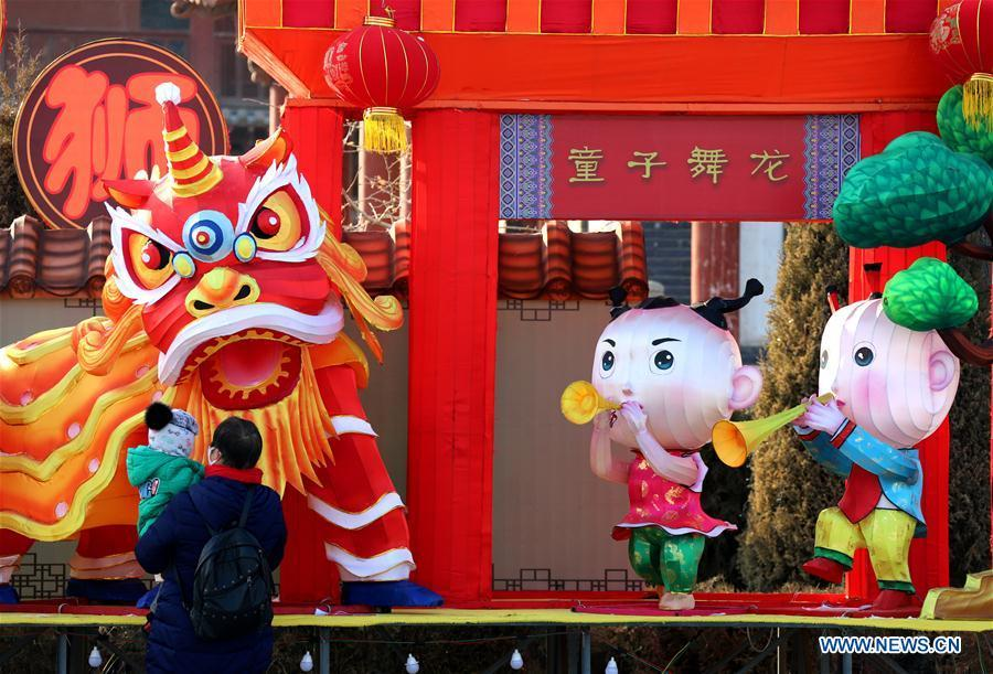 People visit a lantern fair in Zhangye City, northwest China\'s Gansu Province, Jan. 23, 2019. Festive decorations are set up across China to greet the lunar New Year, or Spring Festival, which starts from Feb. 5 this year. (Xinhua/Zhang Yuan)