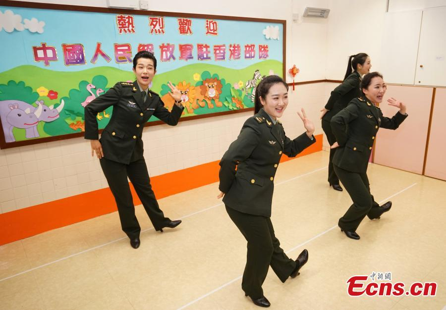 Members of the PLA troops stationed in Hong Kong perform for children at Ka Fuk Baptist Church Pre-School to celebrate the upcoming Spring Festival, China\'s Lunar New Year, in Hong Kong, Jan. 24, 2019. (Photo: China News Service/Zhang Wei)