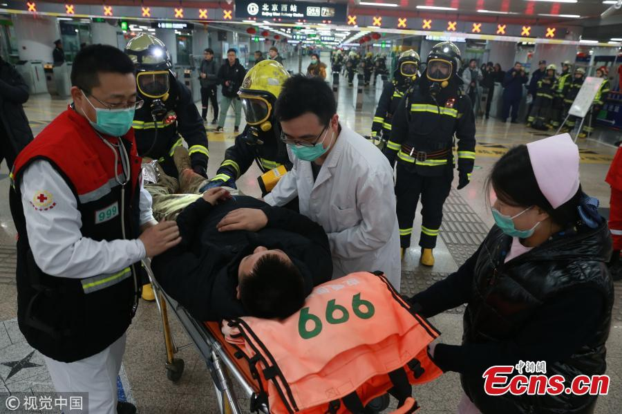 Medical workers participate in a firefighting drill at Beijing West Railway Station on Jan 24, 2019.