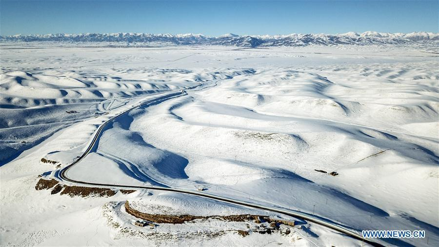 Aerial photo taken on Jan. 18, 2019 shows the snow cover in Zhaosu County, northwest China\'s Xinjiang Uygur Autonomous Region. A nine-member research team with an average age under 30 from the Xinjiang Institute of Ecology and Geography under the Chinese Academy of Sciences started a research on snow cover on the Tianshan Mountains in Xinjiang. Snow cover on the Tianshan Mountains is an important source of water resources. Snowmelt provides an abundant water supply for river flow in this area and also affects the ecological system of agricultural and animal husbandry production in the downstream oasis. (Xinhua/Hu Huhu)