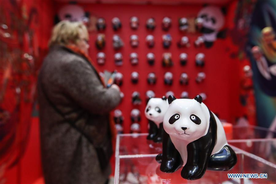 A visitor looks at exhibits in a shopping mall at Potsdamer Platz in Berlin, capital of Germany, on Jan. 24, 2019. \