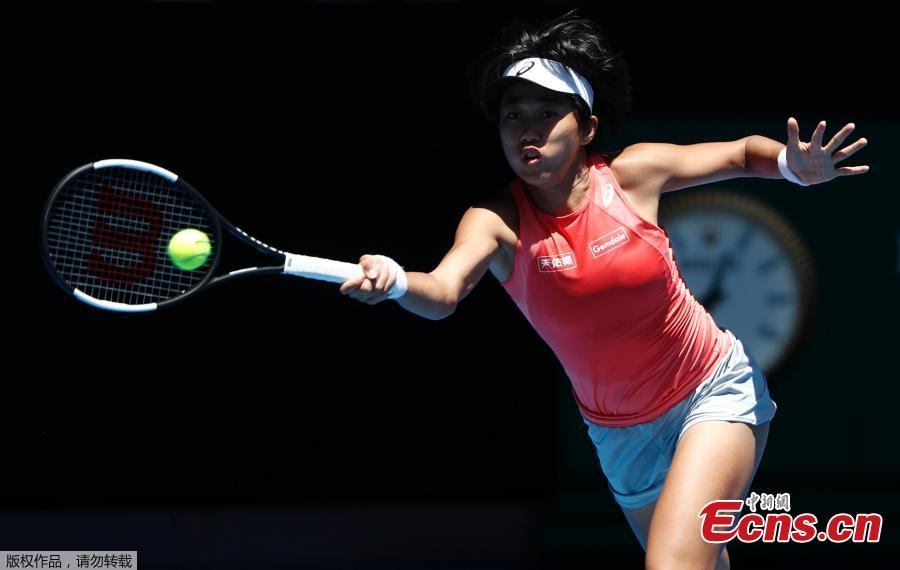 Zhang Shuai of China hits a return during the women\'s doubles final match against Timea Babos of Hungary and Kristina Mladenovic of France at 2019 Australian Open in Melbourne, Australia, Jan. 25, 2019. (Photo/Agencies)