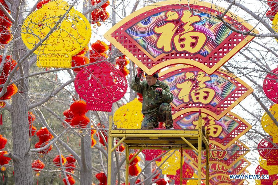 A worker settles decorations for the Spring Festival at the Ditan Park in Beijing, capital of China, Jan. 26, 2019. Red decorations are arranged across China to greet the upcoming lunar New Year which will fall on Feb. 5 this year. (Xinhua)