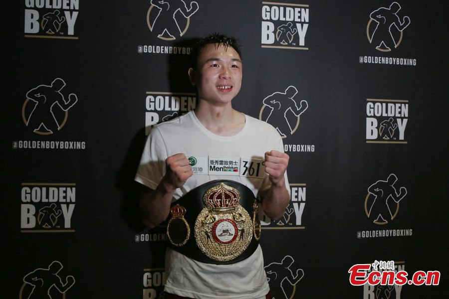 Chinese boxer Xu Can, 24, poses for photo after winning the World Boxing Association (WBA) featherweight title in Houston, the U.S., Jan. 26, 2019. (Photo: China News Service/Zeng Jingning)