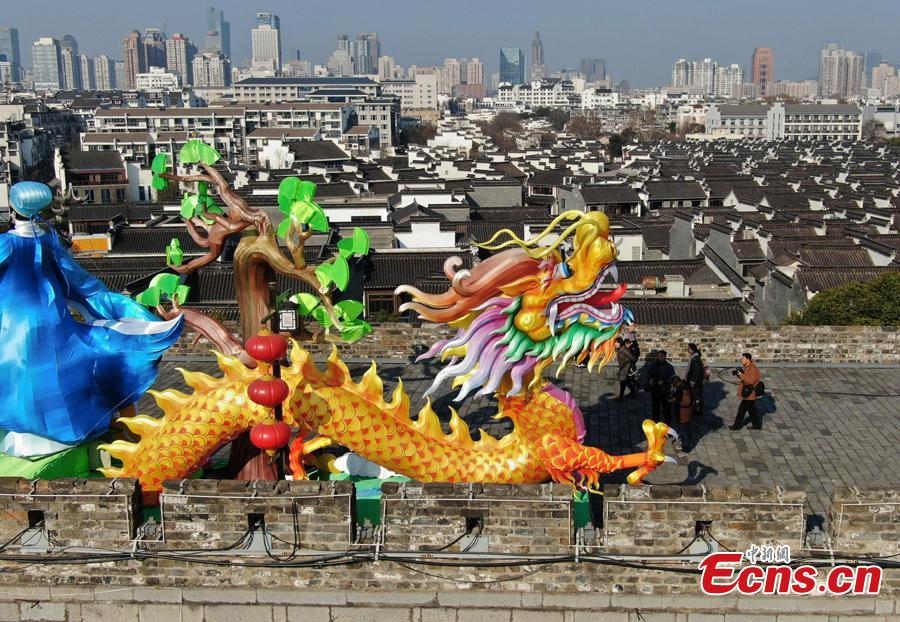 Colored dragon lanterns are installed on the Ming Dynasty (1368-1644) city wall ahead of the Spring Festival, China\'s Lunar New Year, in Nanjing City, Jiangsu Province, Jan. 27, 2019. (Photo: China News Service/Yang Bo)